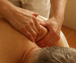 Cleveland AL massage therapist working on shoulder